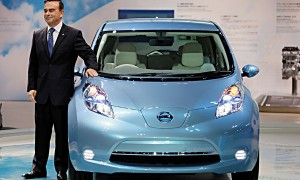 Nissan Motor Co. CEO Carlos Ghosn poses with the automaker' zero